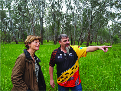 Deborah Glass and Daryl Sloan looking at scar trees near Shepparton