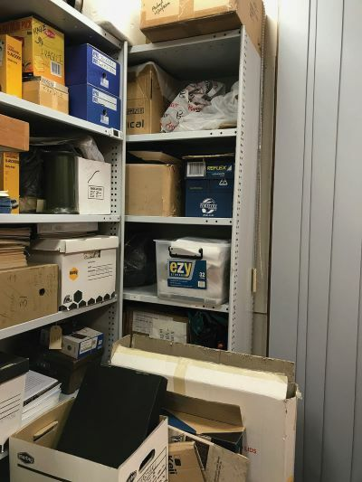 Many kinds of different boxes and containers across several shelves