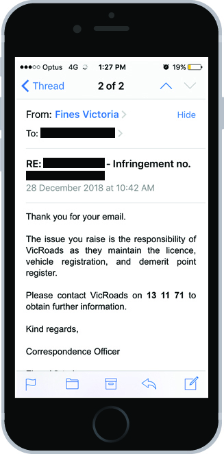An image of a mobile phone with an email on the screen. The email from Fines Victoria says
