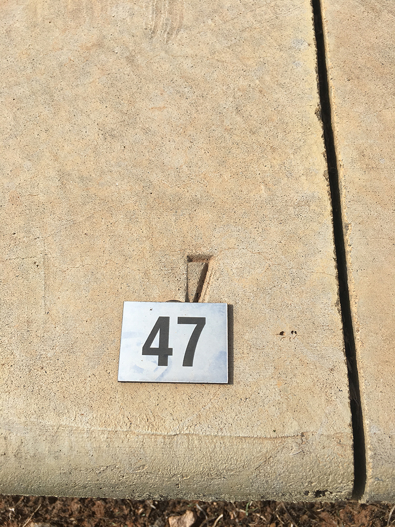 A replacement plaque '47' placed on a plinth which has the number 7 engraved.